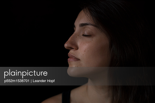 Woman with closed eyes - p552m1538701 by Leander Hopf