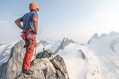 Mountain climber on one of Bugaboo Spires ridges, Bugaboo Mountains, British Columbia, Canada - p1424m1579483 by Suzanne Stroeer
