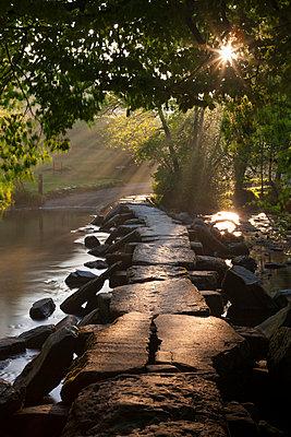 Ancient clapper bridge Tarr Steps spanning the River Barle in Exmoo National Park, Somerset, England, United Kingdom, Europe - p871m1017468 by Adam Burton