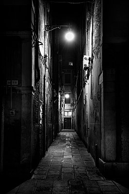 Narrow street at night in Venice (II) - p3314007 by Thomas Ortolan