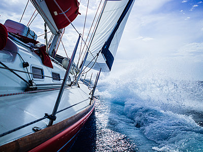 Sailboat in the storm - p1053m1476533 by Joern Rynio