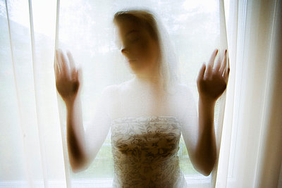 Woman behind curtain - p4130516 by Tuomas Marttila