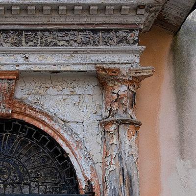 Peeling plasterwork on Venice building exterior. - p8552305 by Mike Burton