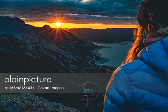 Photographer Watching Sunrise From Mountain Ridge - p1166m2131431 by Cavan Images