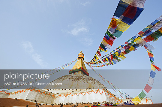 Pigeons and prayer flags on Boudha Stupa (Chorten Chempo), Boudhanath, Kathmandu, Nepal, Asia