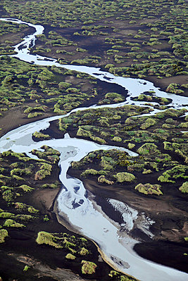 Meandering glacial river in moss covered scenery, Iceland - p1026m992062f by Romulic-Stojcic