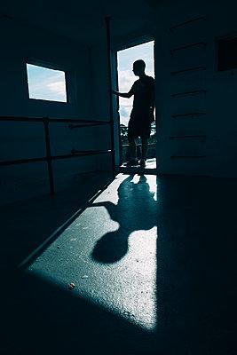 Dark Figure in a Doorway - p1262m1590048 by Maryanne Gobble