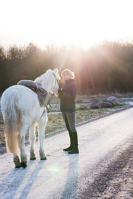 Woman with horse outdoor - p312m1471154 by Viktor Holm