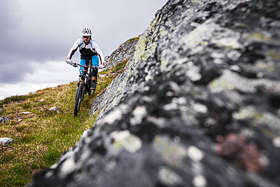 Mountain biker finding some alternative lines in the north of Sweden. - p343m1090340 by Elias Kunosson