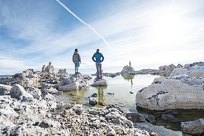 Father and son admiring tufa towers of Mono Lake, California, USA - p343m1490631 by Alasdair Turner / Aurora Photos