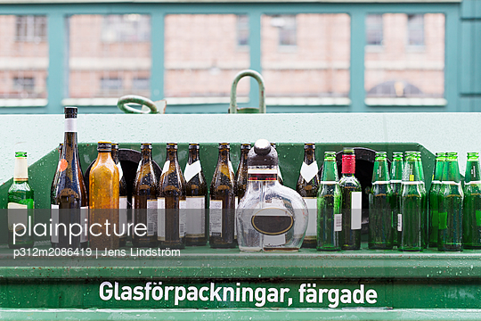 Empty bottles on recycling bin - p312m2086419 by Jens Lindström