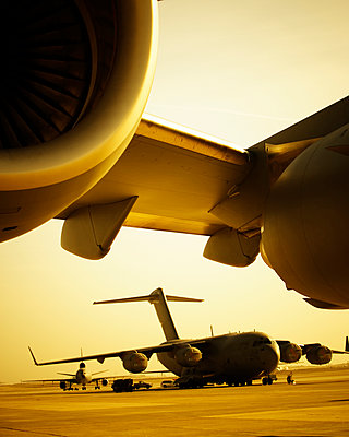 Close up of jet engines with a cargo planes in the background. - p343m1554785 by Ron Koeberer