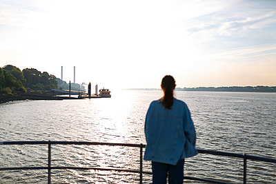Young woman looks out over the Elbe river - p341m2210420 by Mikesch