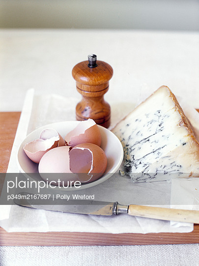 Pepper pot with broken eggshells and blue cheese - p349m2167687 by Polly Wreford