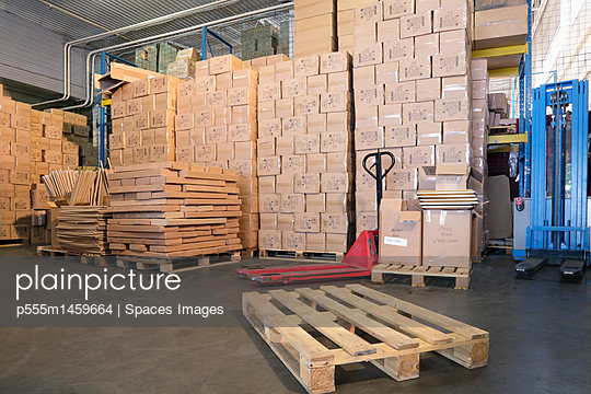 Pallets and cardboard boxes in warehouse