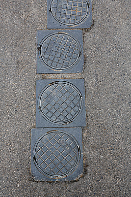 Four manhole covers - p1057m851607 by Stephen Shepherd