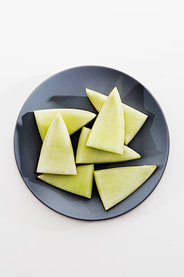 Leftovers of a honeydew melon - p1149m1146843 by Yvonne Röder