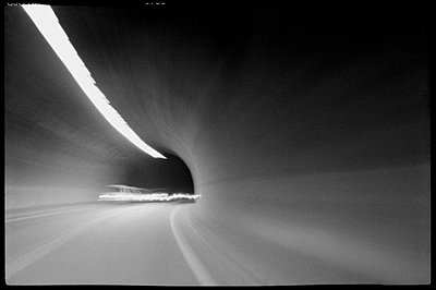 Blurred shot of cars speeding through tunnel - p3720291 by James Godman
