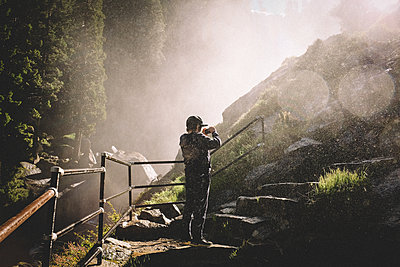 Tween Stops on Vernal Falls Hike to Snap Photo in the Mist - p1166m2261929 by Cavan Images