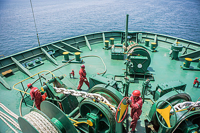 Workers on deck of ship - p1157m1041437 by Klaus Nather
