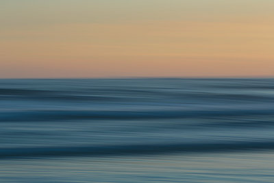 View from the beach over the ocean at sunset, long exposure - p1100m1216309 by Mint Images