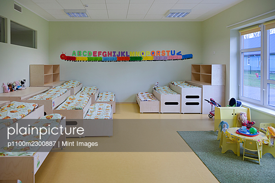 Day care nursery or pre-school kindergarten, bedrooms for nap time, pull out bunks - p1100m2300887 by Mint Images