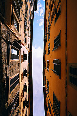 View from below apartment buildings, Florence, Tuscany, Italy - p301m2018495 by Norman Posselt