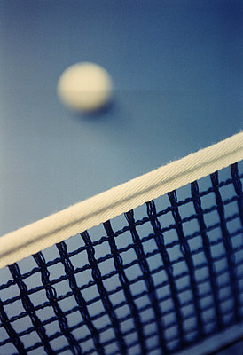 Close-up of a table tennis net with a table tennis ball - p3485420 by Michael Engman