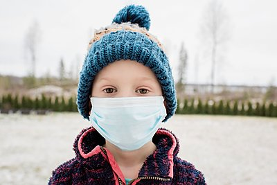young boy with face mask on protecting himself from flu and virus - p1166m2171942 by Cavan Images