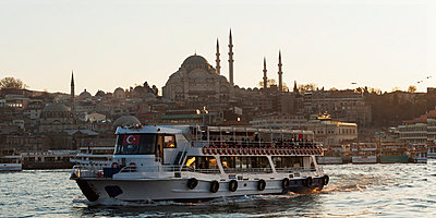 A Boat In The Bosphorus River With Suleymaniye Mosque In The Background; Istanbul Turkey - p442m784333 by Keith Levit