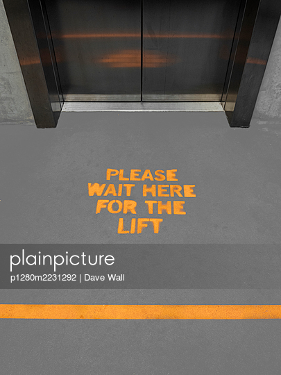 Lift with Social Distancing Signage - p1280m2231292 by Dave Wall