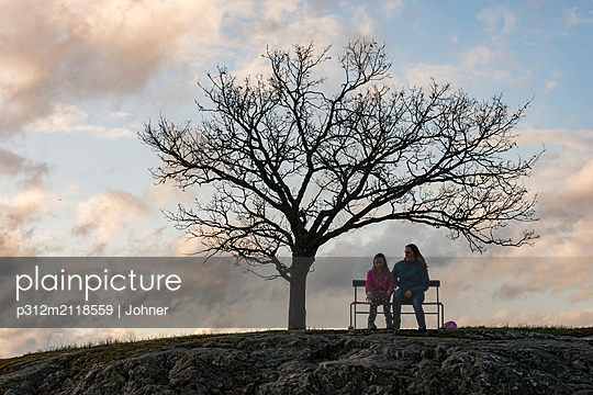 People on bench - p312m2118559 by Johner