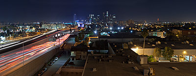 City and highway at night - p555m1479856 by Studio 642