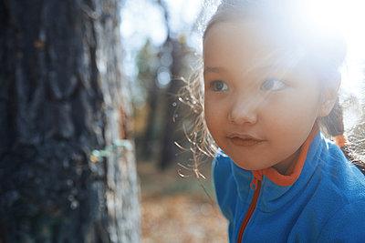 Girl under sunshine in forest - p1427m2067230 by Arman Zhenikeyev