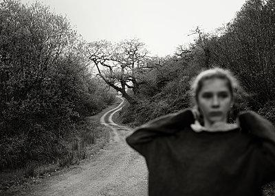 Girl on Dirt Road - p1503m2015948 by Deb Schwedhelm