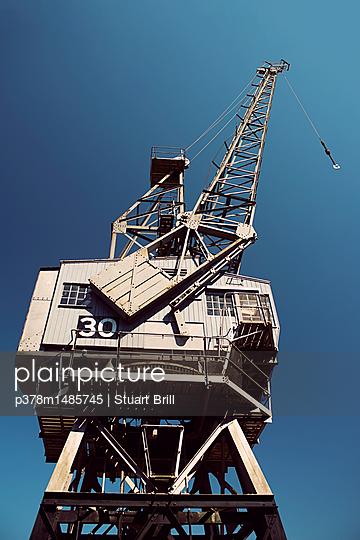 Dock crane - p378m1485745 by Stuart Brill