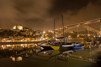 Porto and river Douro at night - p4296052 by Alex Holland