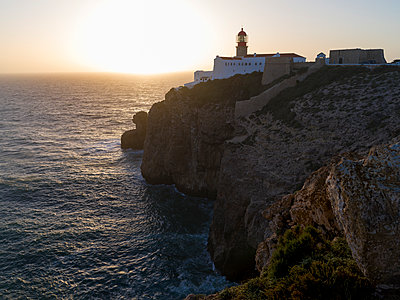 Lighthouse on the steep coast, Cabo de Sao Vicente, Portugal - p1208m2172908 by Wisckow