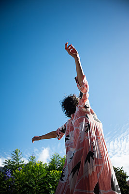Woman with outstretched arms - p1640m2259914 by Holly & John