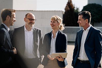Business team having a meeting on factory yard - p300m2171103 by Kniel Synnatzschke