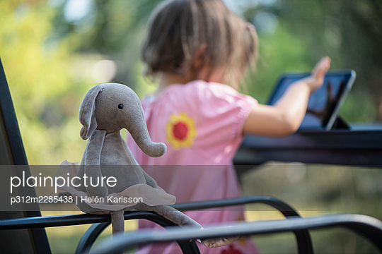 Elephant toy on chair - p312m2285438 by Helén Karlsson