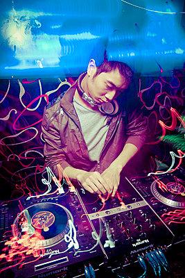 A DJ plays dubstep at Amazon Bar in Hanoi, Vietnam, Asia - p934m832503 by Dominic Blewett