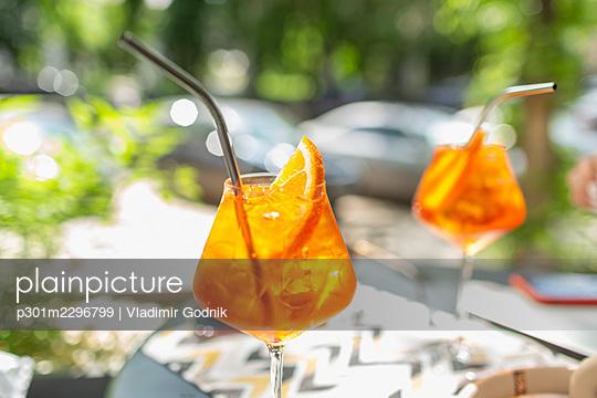 Orange cocktails with metal straws - p301m2296799 by Vladimir Godnik