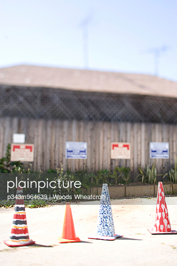 Decorated colorful work cones block a no parking area in a parking lot. - p343m964639 by Woods Wheatcroft photography
