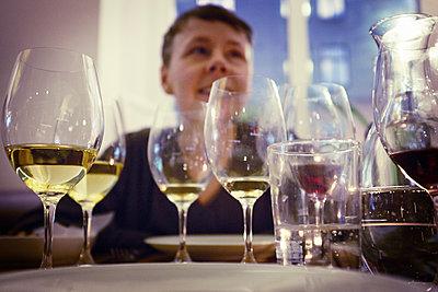 Wineglasses, woman on background - p312m1187685 by Dan Lepp