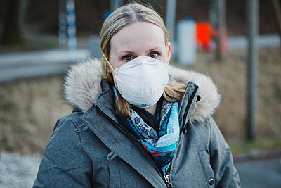 Woman wearing protective mask - p312m2191040 by Madeleine Wejlerud