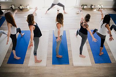 Women at yoga retreat - p429m2019523 by Hugh Whitaker