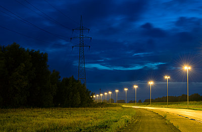 Empty road near Antwerp harbour at night , Antwerp, Belgium - p429m958654f by Mischa Keijser
