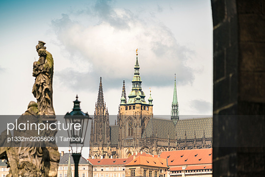 Statues on Charles Bridge with the St. Vitus Cathedral in the background - p1332m2205606 by Tamboly
