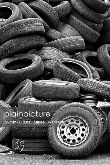 Pile of old tires - p575m711035f by Mikael Svensson